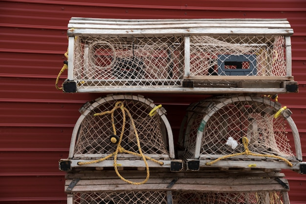 Crab pots stacked by wall, souris, kings county, prince edward island, canada