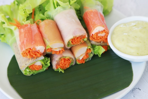 Crab stick salad roll and vegetable with cream sauce diet and clean food