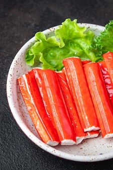 Crab sticks semifinished seafood fresh portion ready to eat meal snack on the table copy space