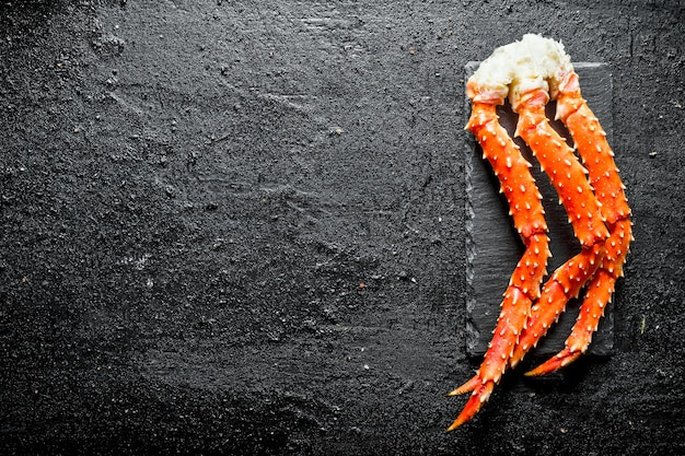 Crab on a stone board.