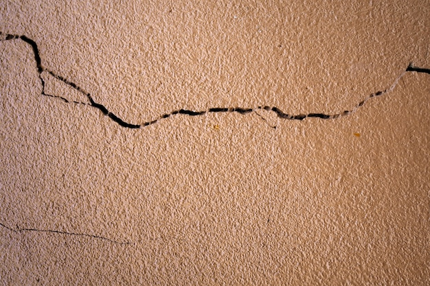 Crack of brown cement wall texture background