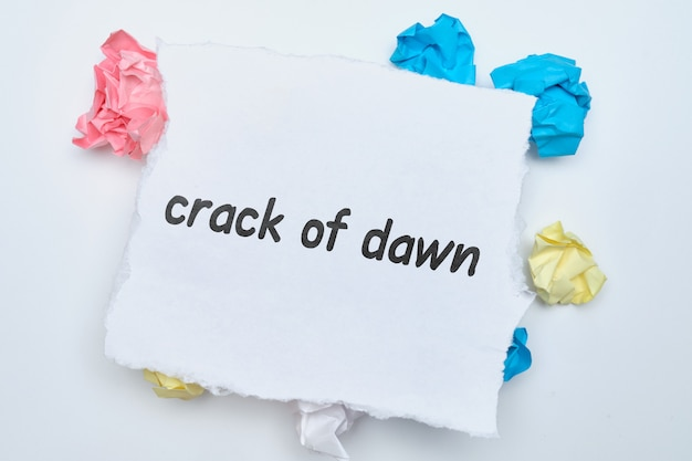 Crack of dawn - english idiom hand lettering on wooden blocks