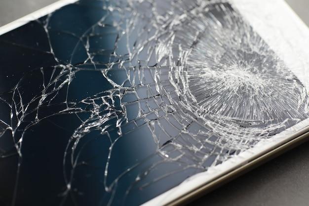 Crack on the glass. broken screen. broken phone. cracked glass background. white cracks in the glass.