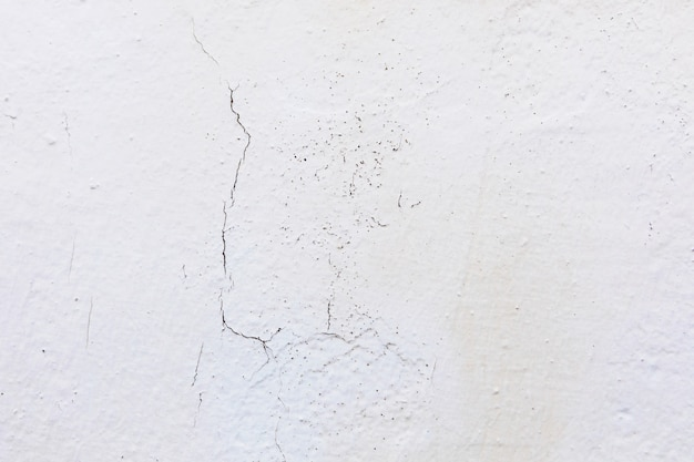 Crack in a wall on a cement surface