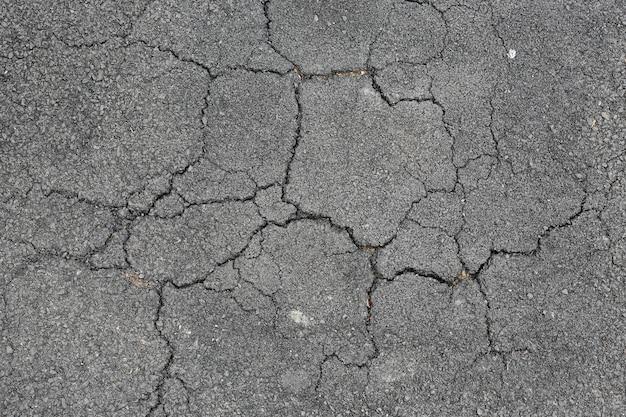 Cracked asphalt background.