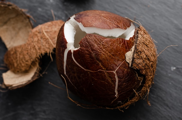 Cracked coconut. exotic food concept.