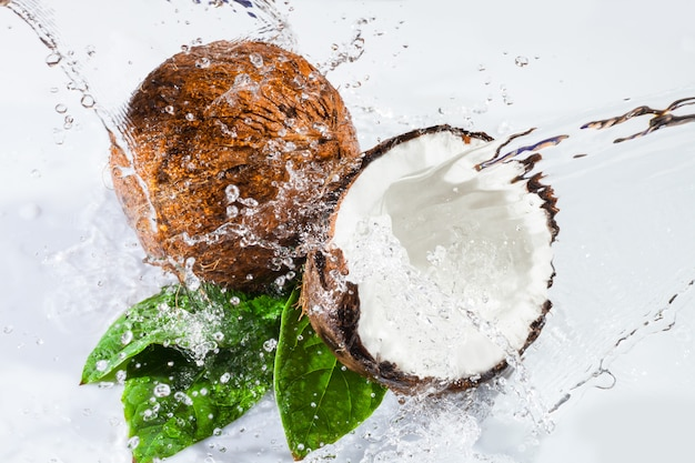 Cracked coconut with leafs