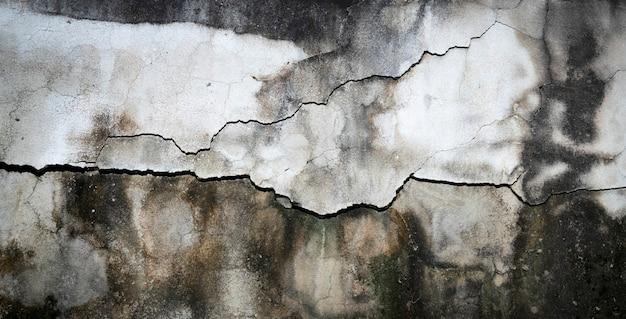 ひびの入ったコンクリートの壁の背景