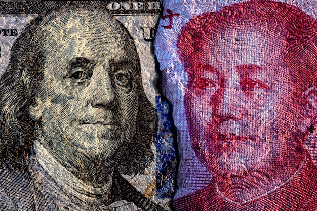 Cracked of face to face of us dollar banknote and china yuan banknote
