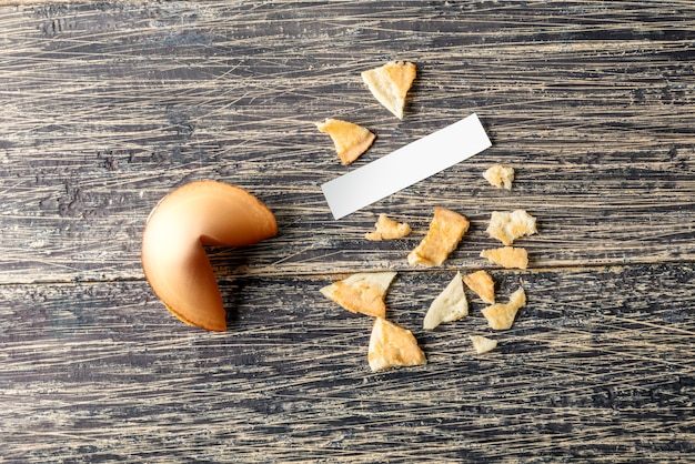 Cracked fortune cookies with blank paper