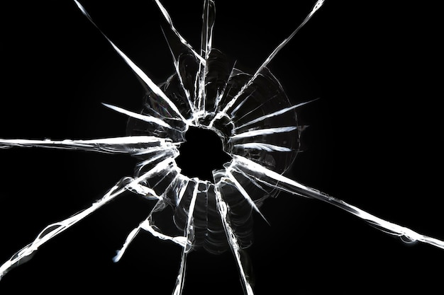 Cracked glass on a black surface