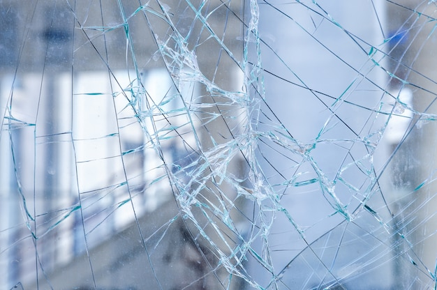 Cracked glass in a shop window background