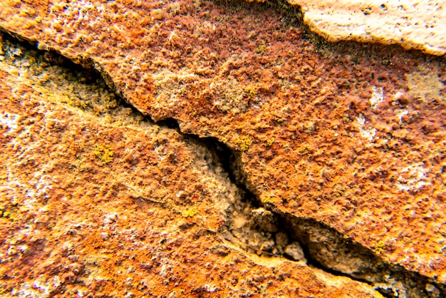 Cracked gray ancient stone close up texture