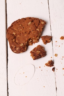 Cracked homemade oatmeal cookie on a table
