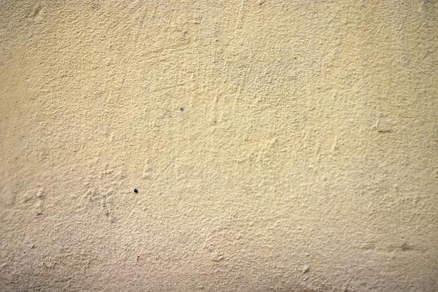 ひびの入った塗料の質感と傷のプラスター。