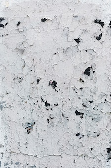 Cracked painted white wall texture