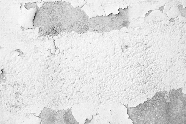 Cracked and peeling of white color paint on concrete wall texture and background