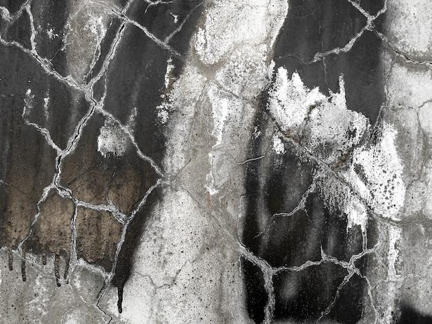 Треснувшая штукатурка на стене. текстура гранжа