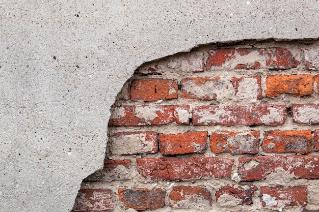Cracked wall, textured brick background, red brick