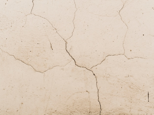 Cracked white wall textured background
