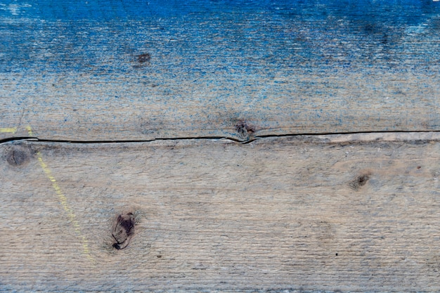 Cracked wooden board painted blue, natural wood board, wood stained blue