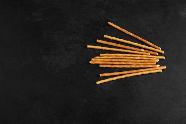 Cracker sticks on a black background.