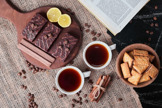 Crackers and chocolate waffles with tea