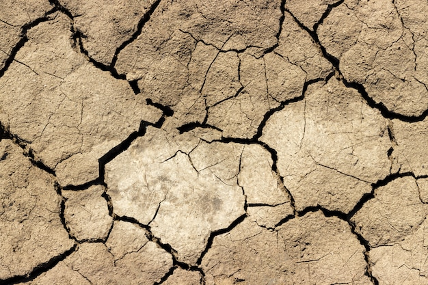 Cracks in the ground background, black earth