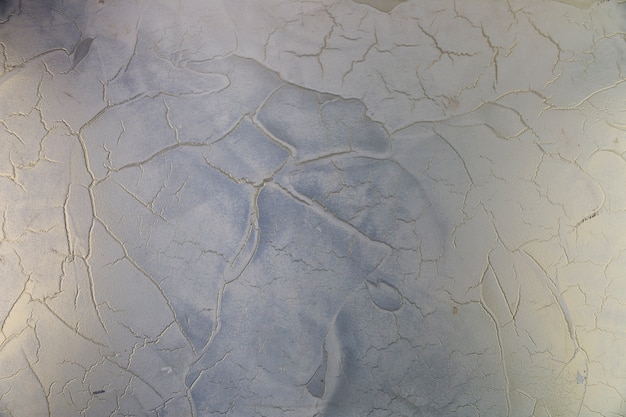 Cracks in rough concrete wall surface