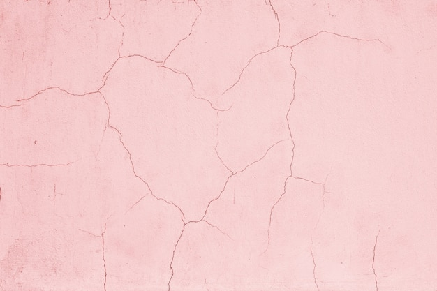 The cracks in the shape of a broken heart on pink