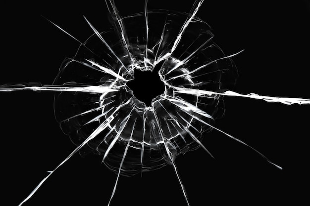Cracks in the window from a shot from a weapon
