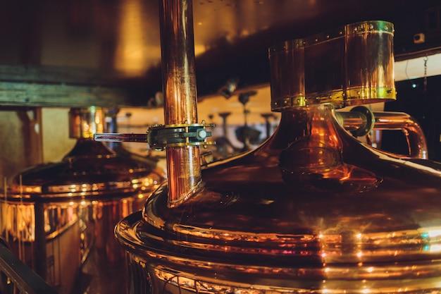 Craft beer brewing equipment in brewery metal tanks