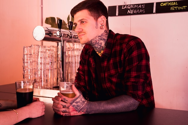 Craft beer concept with tattooed man
