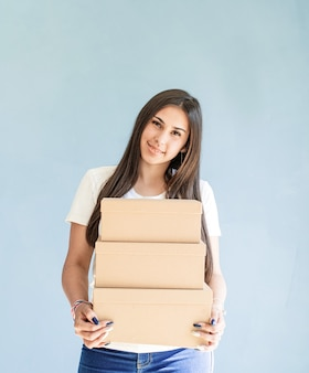 Craft boxes in woman hands beautiful smiling woman holding blank boxes
