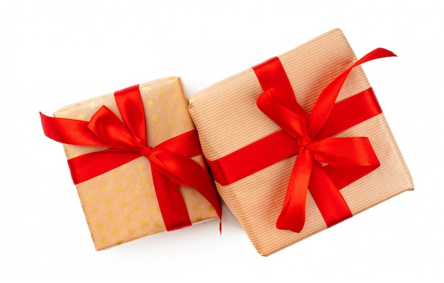 Craft christmas gifts with red bows isolated on white background
