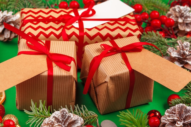 Craft christmas gifts with red ribbons on decorated christmas