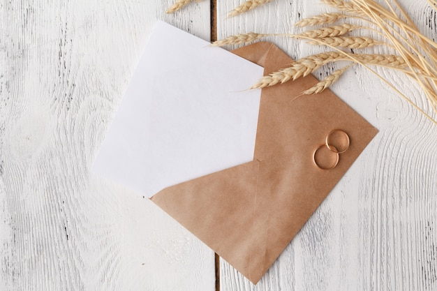 Craft envelope with two rings for wedding invitation