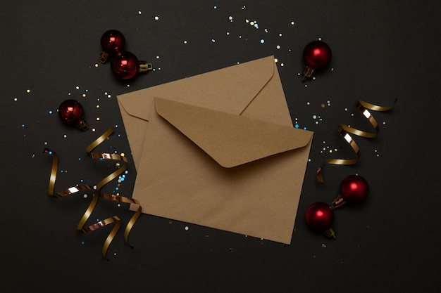 Craft envelopes decoration with red ribbons
