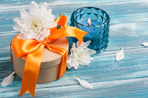 Craft gift box with orange ribbon