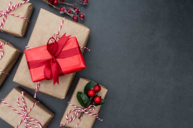 Craft gift boxes over dark background. christmas mock up with copy space.