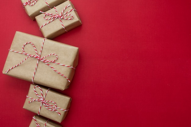 Craft gift boxes over red background. christmas mock up with copy space.