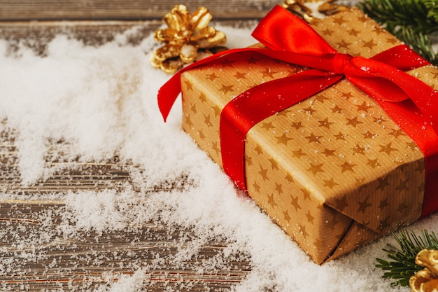 Craft gift boxes over snowy wooden table close up