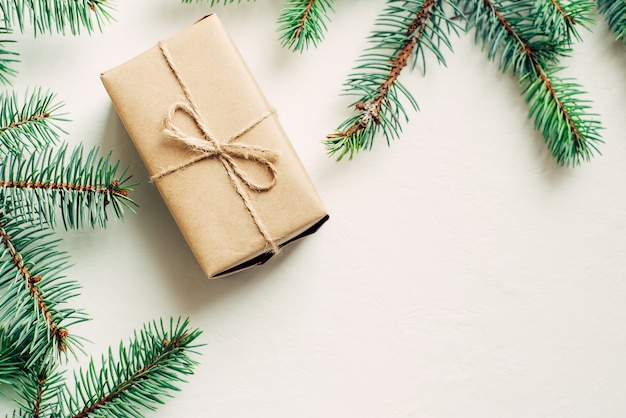 Craft gift boxes and spruce branches on a white background