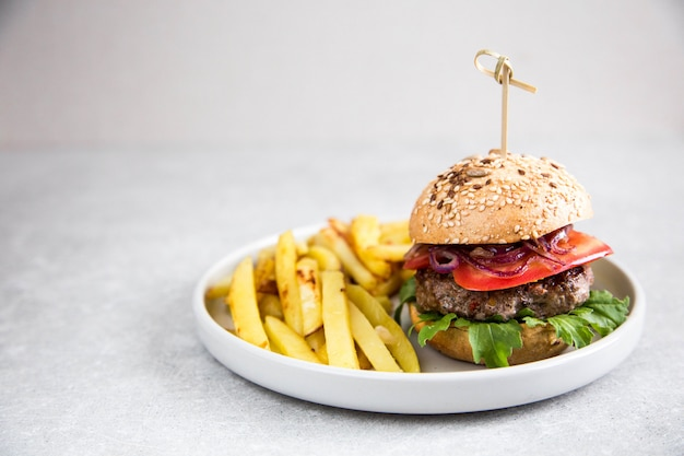 Craft homemade beef burger and french fries.
