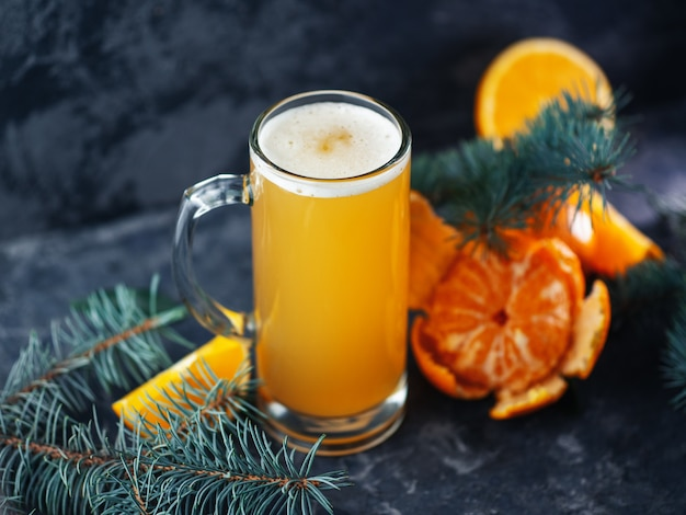Craft limited edition christmas orange and tangerine beer ale on dark table