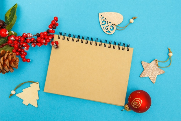Craft notebook on a blue background glasses and christmas toys