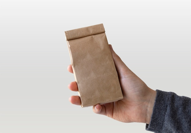Craft paper bag in hand