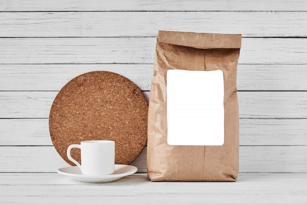 Craft paper bag on white surface, copy space