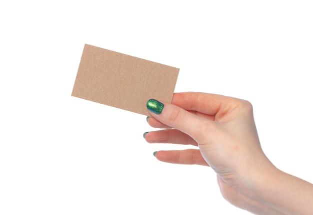 흰색 바탕에 고립 된 여성 손에 공예 종이 카드