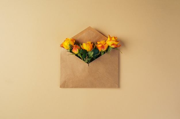 Craft paper envelope with yellow roses